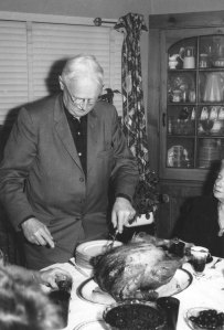 Grandpa Perry carving the turkey